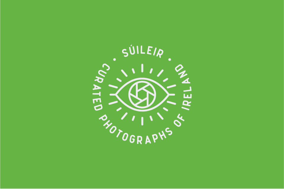 suileir stamp logo reversed